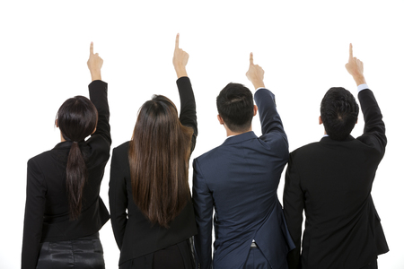 Group of Asian business people pointing at something. Raising their hands up and showing. Isolated on white background. photo