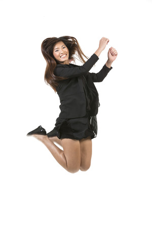 Chinese Business woman jumping in the air. isolated on a White Background