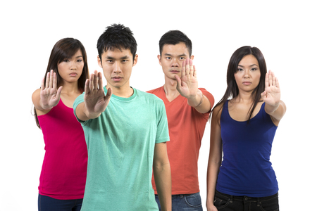 nagging: Group of Chinese friends with hands up to STOP. Isolated over white background.