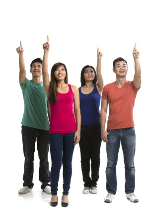 chinese adult: Group of happy Chinese friends pointing upwards. Isolated on a white background.