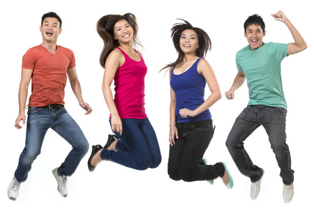 Happy group of Chinese friends jumping. Isolated over white background