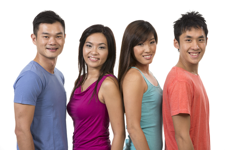 group of young adults: Happy group of Chinese friends. Isolated on a white background. Stock Photo