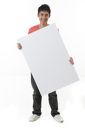 Chinese man holding up a banner against a white background. Cardboard placard is blank ready for your message. Stock Photo - 24120536