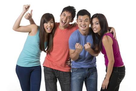 south asian: Happy group of Chinese friends celebrating good news. Isolated over white background Stock Photo