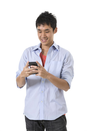 Happy Chinese man using a smartphone. Isolated against white background.