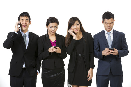 Chinese business team using modern smartphones. Isolated on white background.  photo