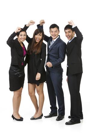 Happy Chinese business team celebrating success. Isolated on white background Stock Photo - 24120864
