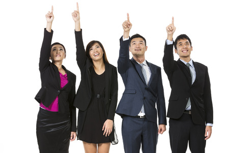 raising hand: Group of Asian business people pointing at something. Raising their hands up and showing. Isolated on white background. Stock Photo