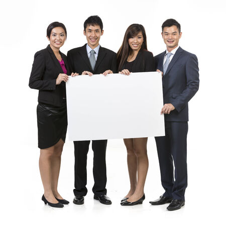 Group of Chinese businesspeople with a banner ad. Isolated on white background. photo