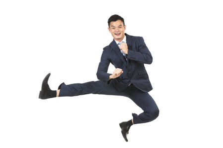 people in action: Chinese Business man jumping in the air. isolated on a White Background