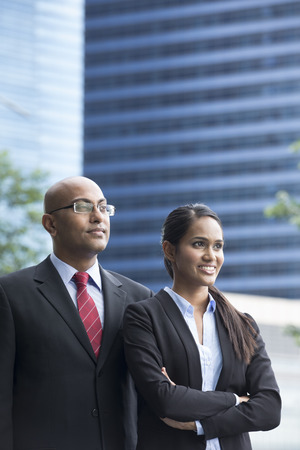 Portrait of Indian business man and woman in a modern urban setting. photo