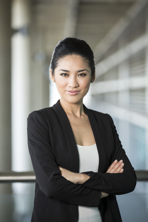 Portrait of a confident Chinese business woman. Happy Asian businesswoman.