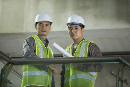 Portrait of two male Chinese industrial engineers at work photo