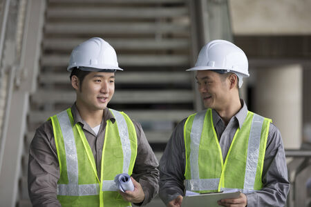 Portrait of two male Chinese industrial engineer's at work Stock Photo