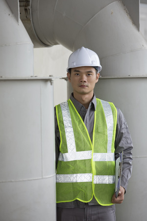 Portrait of a male Chinese industrial engineer at work photo