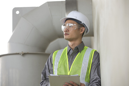 Portrait of a male Chinese industrial engineer at work