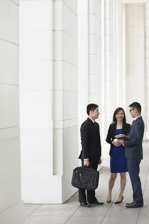 asian office lady: Happy Chinese Business colleagues outside the office talking to each other. Stock Photo