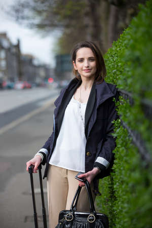 Portrait of a stylish caucasian woman in the city. business or lifestyle image. photo