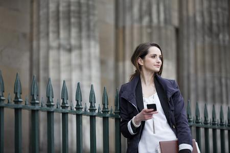 european ethnicity: Modern Caucasian Business woman, talking on mobile smart phone outside. Beautiful young professional European businesswoman. Caucasian ethnicity.