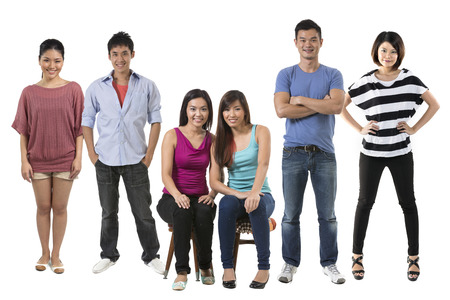large family: Portrait of a group of Happy Chinese people in there 20s. Isolated over white background Stock Photo