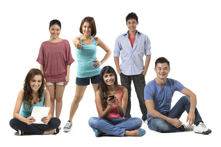 south asian: Portrait of a group of Happy Asian people in there 20s. Isolated over white background Stock Photo