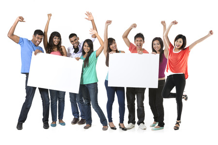 celebrating: Two Groups of Asian people holding a big banner for your message. Indian and Chinese teams holding placards and celebrating good news. Isolated over white background.