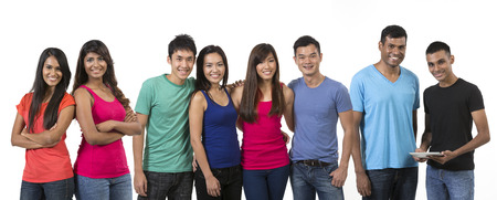 south asian: A large happy group of Asian friends. Isolated on a white background. Stock Photo
