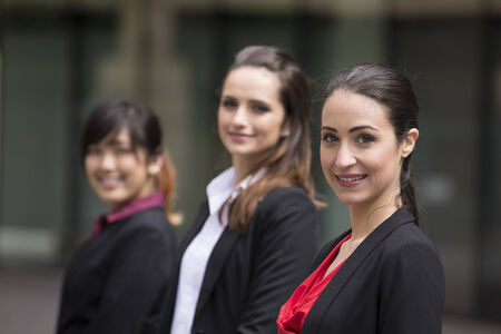 three people only: Portrait of three business women. Focus is on caucasian woman at the front. Interracial group of business women.
