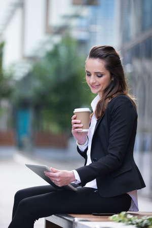 Portrait of a Caucasian businesswoman outside using a Tablet PC. photo
