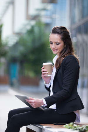 outdoor  outside: Portrait of a Caucasian businesswoman outside using a Tablet PC. Stock Photo