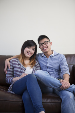 two women hugging: Portrait of happy young Couple relaxing at home.