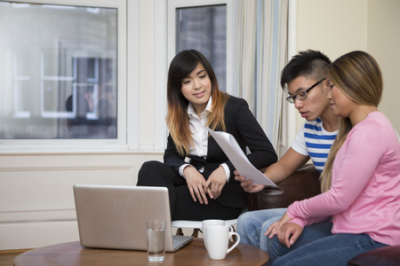 Asian couple meeting financial adviser for investment planning.