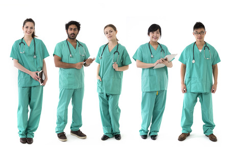 healthcare team: A group Portrait of five multi-ethnic Asian healthcare workers wearing uniforms. Medical team Isolated on a White Background.