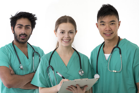 A group Portrait of three multi-ethnic Asian healthcare workers wearing uniforms. Medical team Isolated on a White Background. photo
