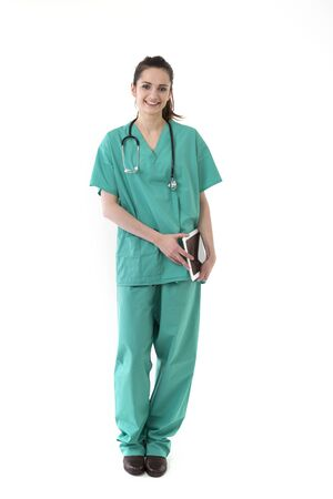Female doctor wearing a green scrubs and stethoscope. Isolated on white. photo