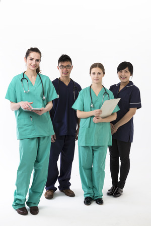 A group Portrait of four multi-ethnic Asian healthcare workers wearing uniforms. Medical team Isolated on a White Background. photo