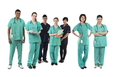 A group Portrait of seven multi-ethnic Asian healthcare workers wearing uniforms. Medical team Isolated on a White Background. photo