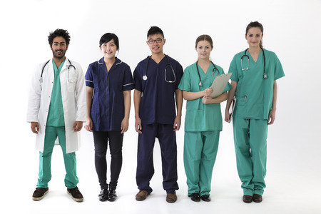 A group Portrait of five multi-ethnic Asian healthcare workers wearing uniforms. Medical team Isolated on a White Background. photo