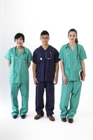 A group Portrait of three multi-ethnic healthcare workers wearing uniforms. Caucasian & Chinese Medical team Isolated on a White Background. photo