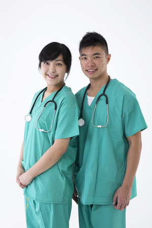 chinese medical: Portrait of two Chinese Medical professionals wearing medical scrubs and stethoscope. Isolated on white background.