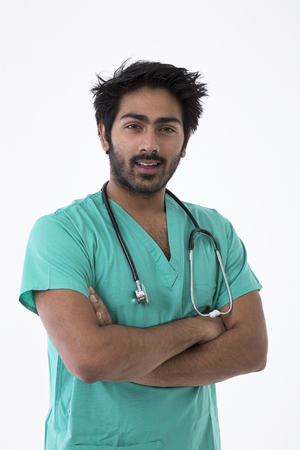 Male Indian doctor wearing a Green Scrubs & a stethoscope. Isolated on white background. photo
