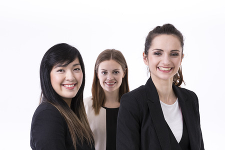 Caucasian and Chinese business women wearing office suits. Isolated on white background. photo