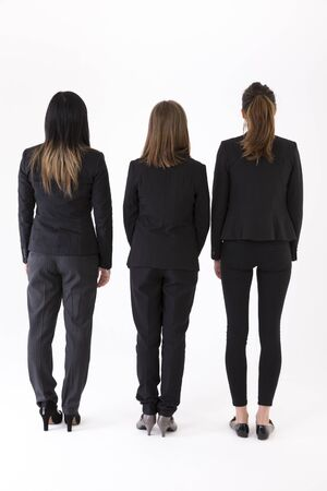 woman back view: Back view of a Group of Businesswomen. Isolated on a white background.