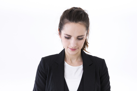 stressed business woman: Portrait of tired or depressed young business woman. Isolated on white background. Caucasian brunette female model.