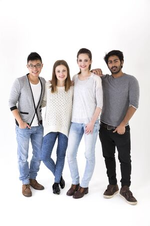 smiling teenagers: Happy group of friends. Mixed race group. Isolated on a white background.