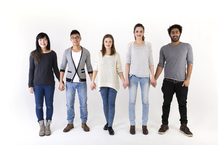 holding close: Happy group of friends holding hands. Mixed race group. Isolated on a white background. Stock Photo