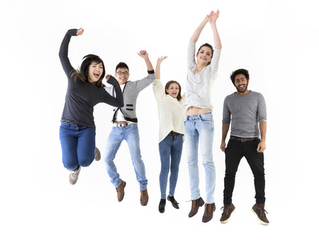 Happy group of five friends jumping. Isolated over white background photo