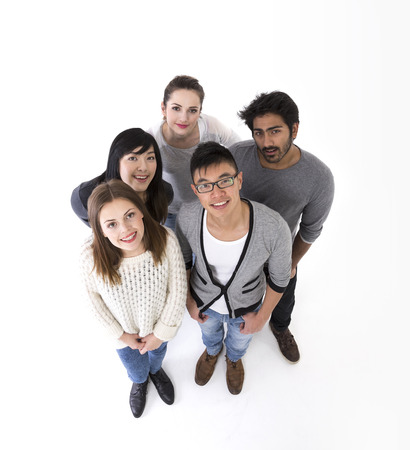 white people: above view of a happy group of friends. Mixed race group. Isolated on a white background.