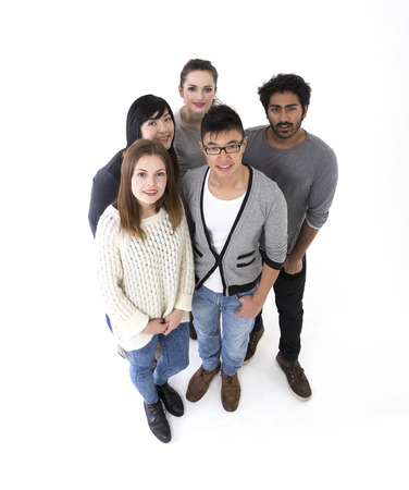 20s adult: above view of a happy group of friends. Mixed race group. Isolated on a white background.