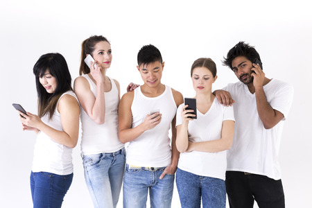 Happy group of friends using there Smartphones. Mixed race group. Isolated on a white background. photo
